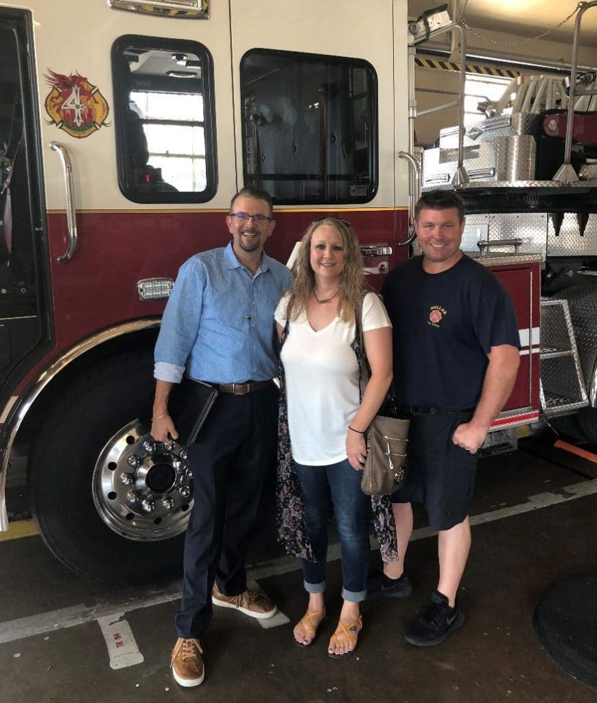 La Hacienda's Cade Saurage and Ashley Martel visit with Dallas Fired Department first responder Casey Ellsworth.